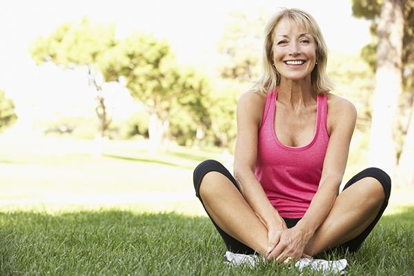 Lady sitting crosslegged in grass